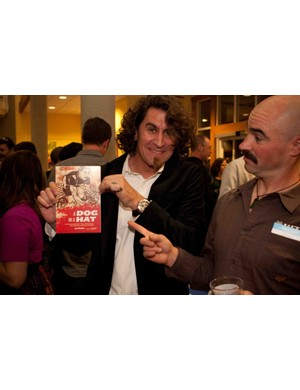 Former road and dirt pro-turned author Joe Parkin shows off his first book with friend Mark Weir.