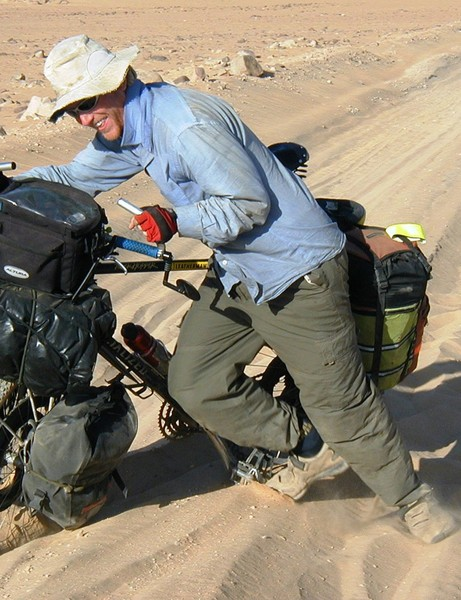 Veteran round-the-world cyclist Alastair Humphreys pushing through the desert