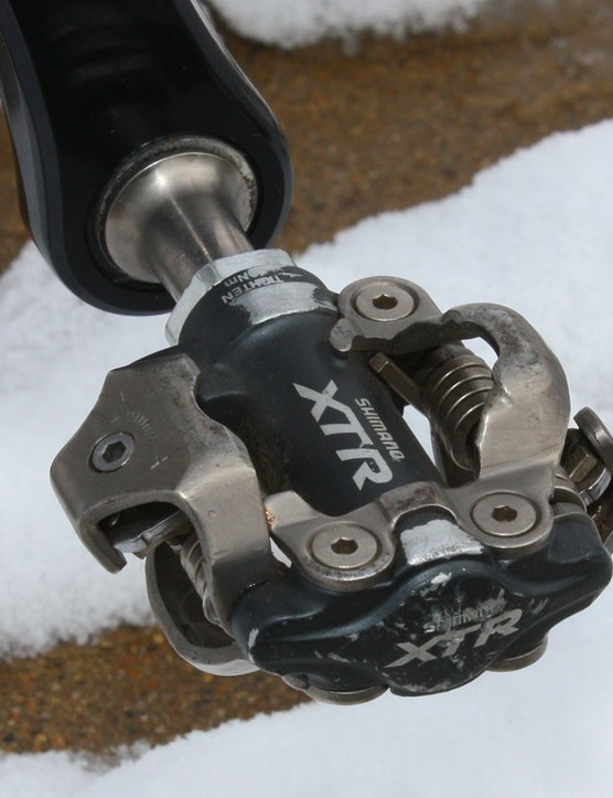 Shimano XTR pedals offer dependable performance with stout bearings proven to hold up well to mud