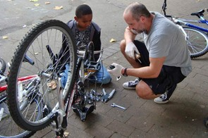 Getting a bike back into working order at St Paul's Adventure Playground