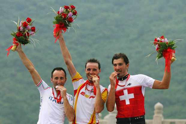 Davide Rebellin of Italy (L), Samuel Sanchez of Spain (C), and Fabian Cancellara of Switzerland (R) pose for pictures on the podium of the men's road race at the 2008 Beijing Olympic Games.