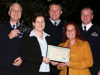 The police Blue Wheelers team receive their award