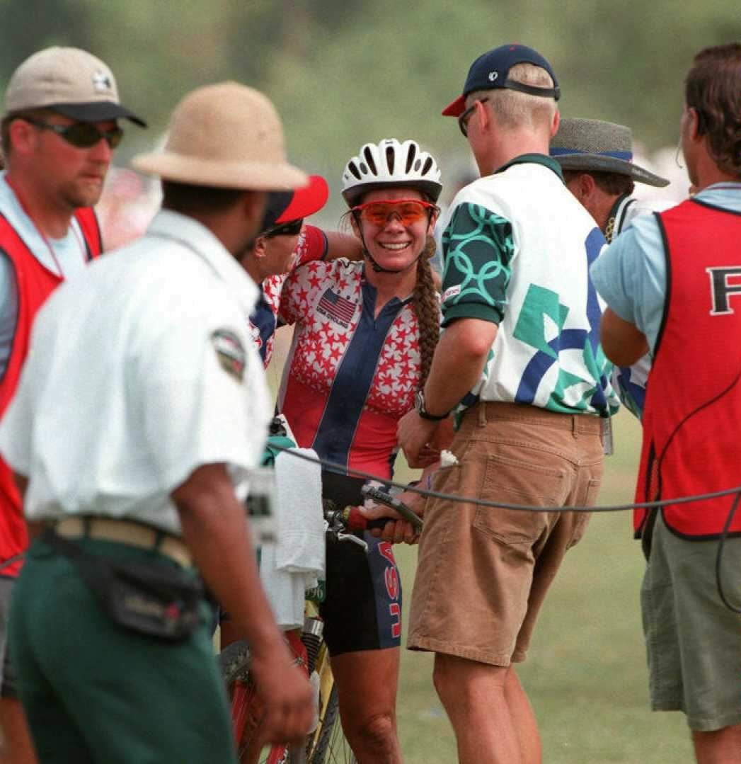 Susan mobbed by race officials, photographers and her then-fiance Dave Wiens at the end of the women's Olympic cross-country race in Atlanta in 1996