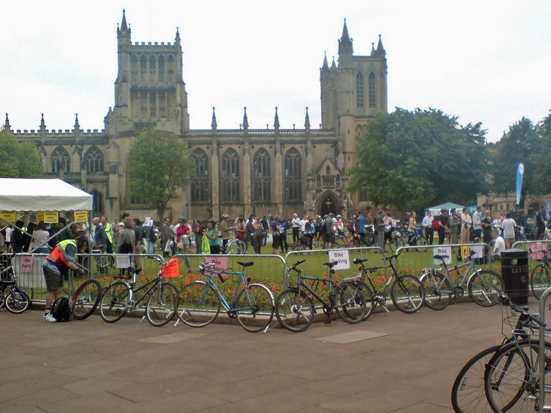 Cyclists queue for a Bike Breakfast outside Bristol Cathedral