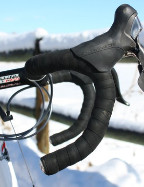 We're used to seeing upturned bars and high-mounted levers on pro 'cross bikes but Kabush's setup is especially so