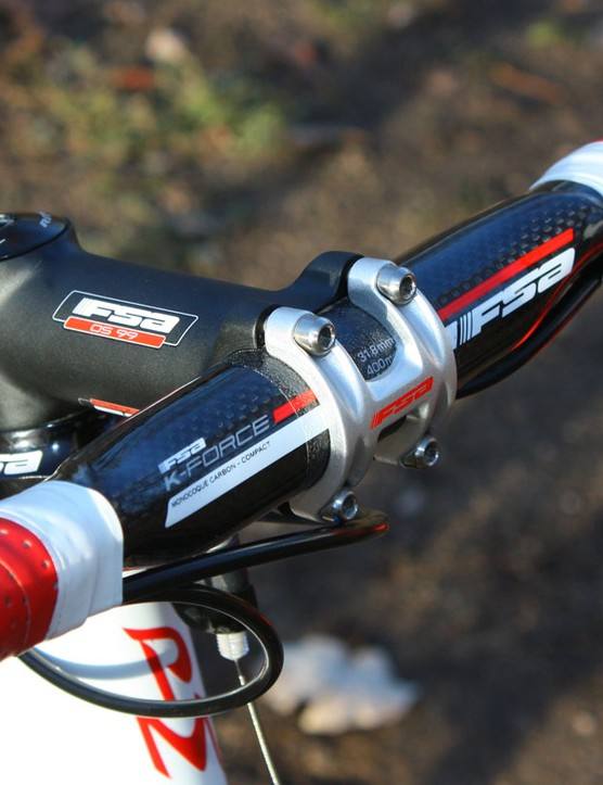 A carbon FSA K-Force Compact bar is clamped into an OS-99 forged alloy stem