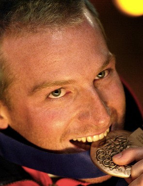 Olympic skier Alain Baxter will compete  in the 200m time trial at the Revolution track cycling event in Manchester next month