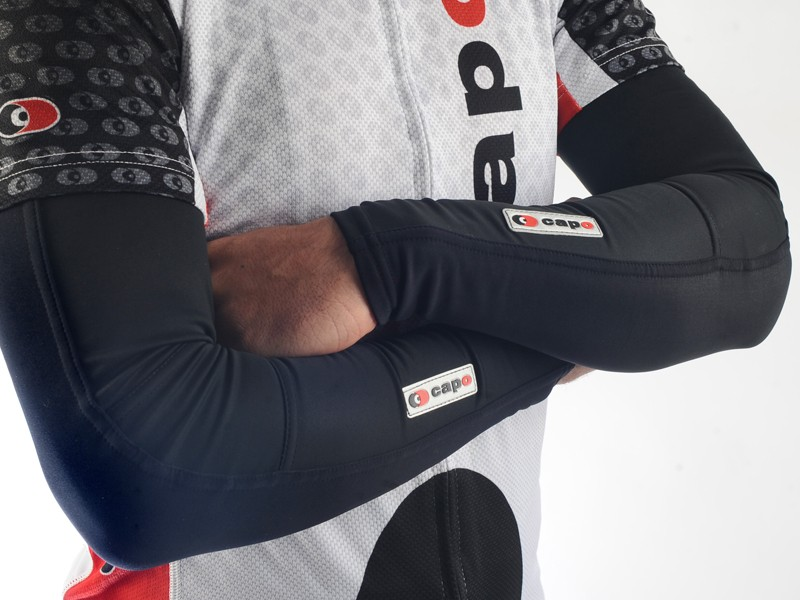 The Capo Limited Edition Roubaix arm warmers blend a wind- and water-resistant front surface with a thermal Super Roubaix back
