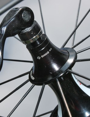 The rear hub's bearing adjustment requires you to loosen the end caps first