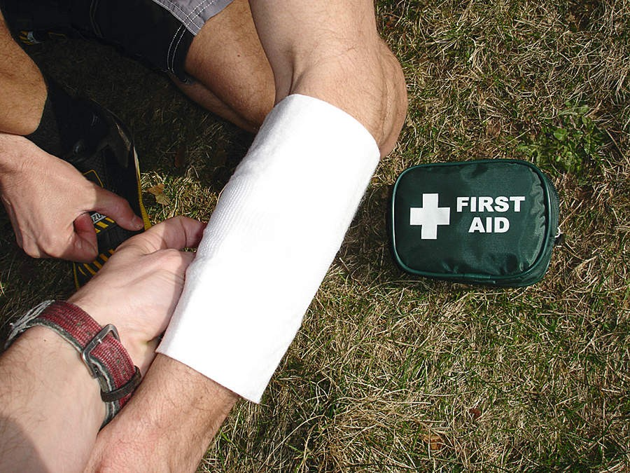 Apply direct pressure with the bandage