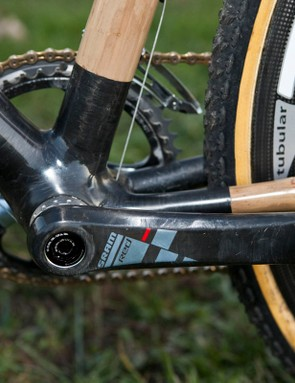 The carbon fibre bottom bracket area includes a conventional threaded shell