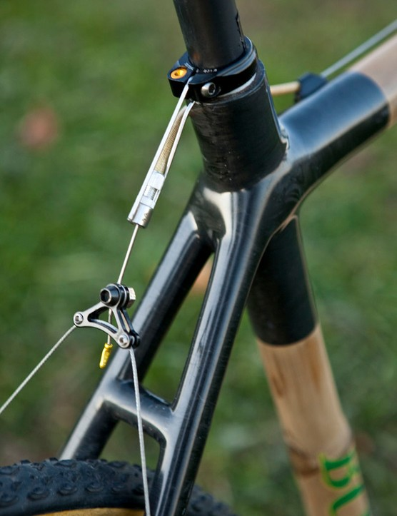 The rear brake housing stop hangs off the seatpost collar instead of being incorporated into the upper stays
