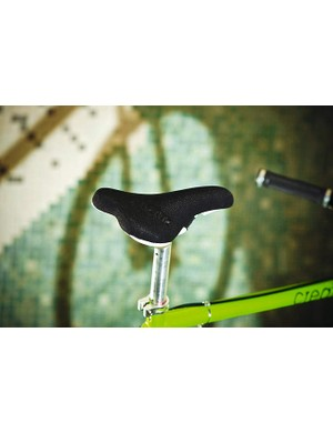 The saddle is great with plastic under the nose that makes shouldering the bike comfortable