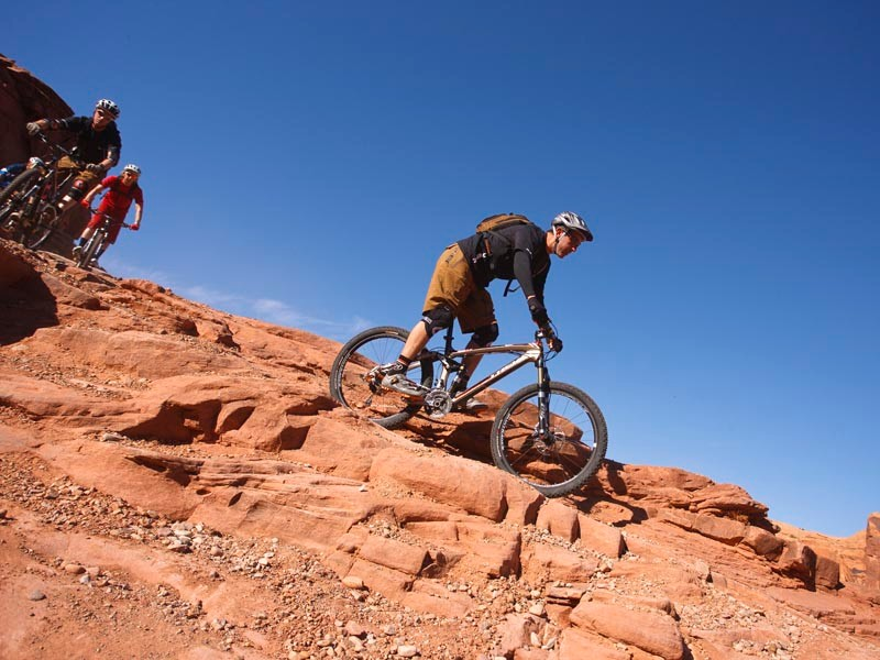 Jose leads Buckle and Doddy on the Amasa Back trail