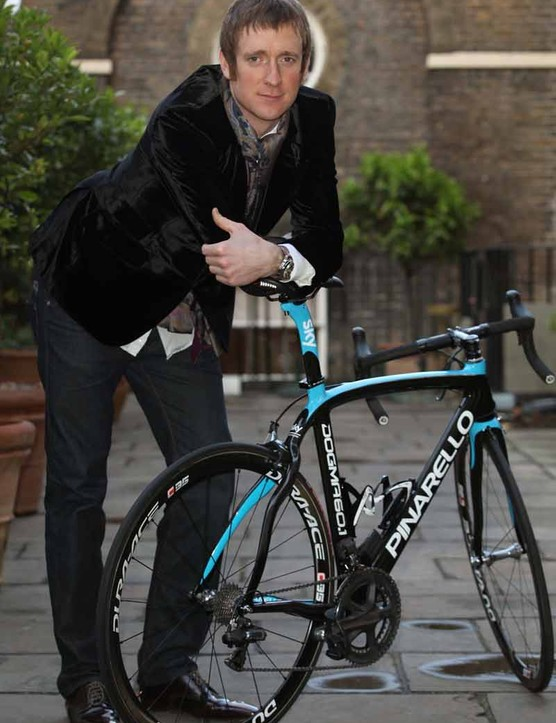 Brad Wiggins poses with one of the new Team Sky Pinarello Dogmas