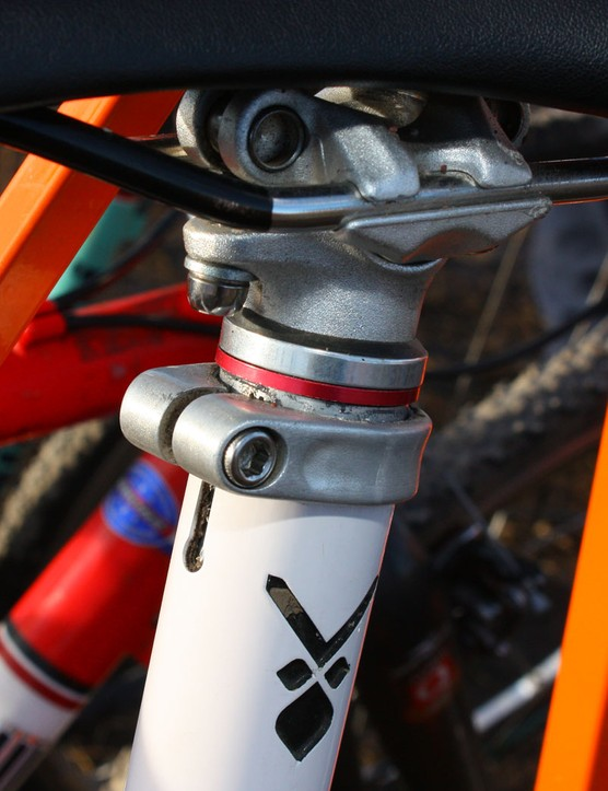 Conventional headset spacers help lock in the saddle height in addition to the conventional seatpost clamp