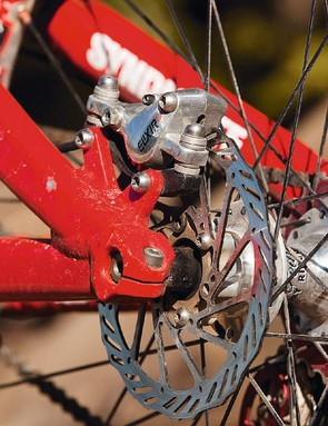 The small rotors are held onto the hubs with just three titanium bolts each.