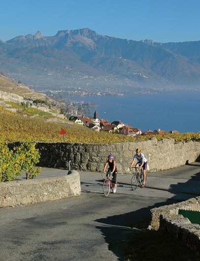 Cycling through the UNESCO World Heritage wine growing region of Lavaux, alongside Lake Geneva
