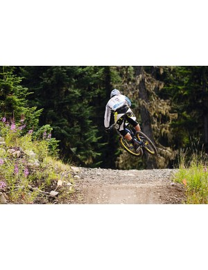 As Chris hits the face of the jump he lays the bike over and scrubs it