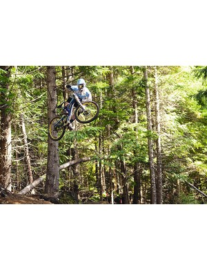 With massive travel bikes capable of big hits, it feels great getting sideways at head height – Chris  throws a huge one in Whistler