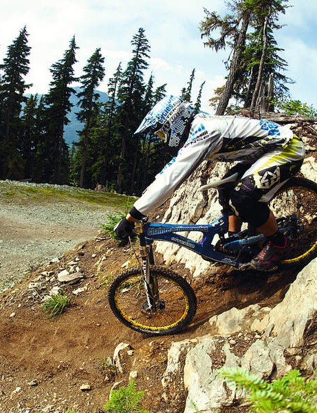 Rolling over the first drop, Chris is gently scrubbing his brakes, and releases slightly to let the bike drop