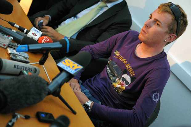 Ricardo Ricco answers journalists' questions after he was interviewed by an anti-doping prosecutor, in Rome on July 30, 2008
