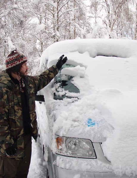 Dusting the snow off the taxi