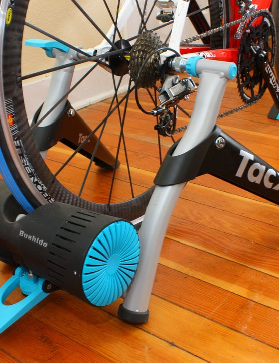 The folding trainer frame is stable and easy to set up though a bit slippery on hard surfaces
