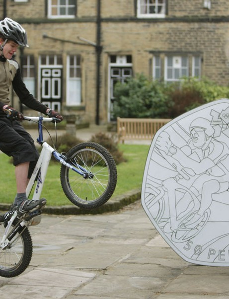 Keen cyclist Theo Crutchley-Mack, 16, has won a competition to design a cycling-themed 50p piece for the London Olympics