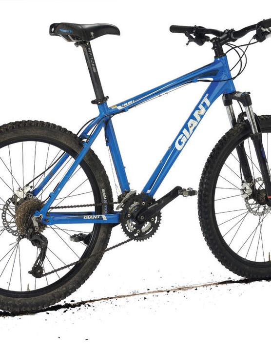 The substandard fork and brakes choke the obvious potential of an outstanding trail frame