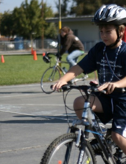 Participating in Street Smart bike rodeo.
