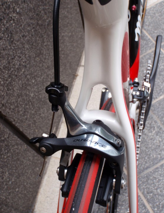 A wide wishbone section near the top tube junction contrasts with the thinner-profile lower section of the seat stays