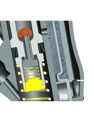 A thumb-operated dial rotates an internal cam (orange) on which the poppet valve (dark grey) rests.  When depressing the master cylinder lever, oil is free to pass through the center of piston until the popper valve seals against the main piston, thus sealing the chamber and then forcing fluid through the hose.