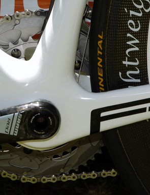 The internally guided derailleur cable housing runs down and around the BB30 bottom bracket shell