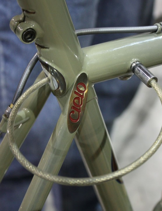 Simply pull out the cable (which is held in place with magnets and sealed in the frame with o-rings) and plug it into the receptacle on the top tube.  The key cylinder is on the underside.  Though not exactly terribly secure, it's undoubtedly trick.
