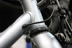 The Di2 wire enters the frame just aft of the head tube at this neat brazed-on port