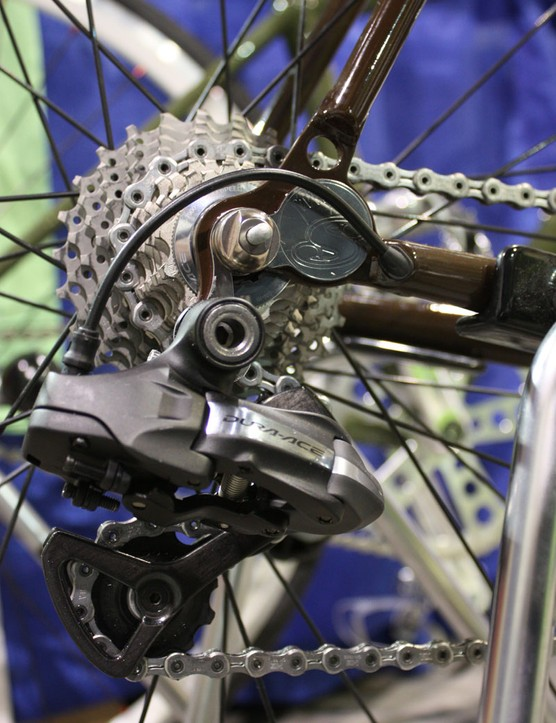 The rear derailleur wire exits neatly just ahead of the polished dropout