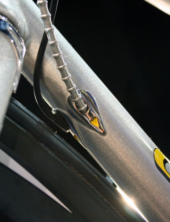 Ornate entry ports for the Di2 wire and rear brake cable are brazed to the underside of the down tube