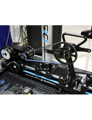 The adjustable crank is connected to the integrated Computrainer via a Gates carbon belt drive