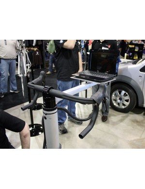 A quick-release clamp makes it easy to swap out bars while the integrated laptop stand allows customers to instantly see the effect of changes