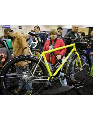 This gleaming yellow titanium hardtail was shown off with studded tyres and chrome fenders