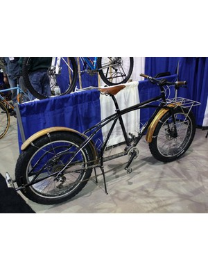 Aaron Rogers of Banjo Cycles built this heavy duty hauler for a customer in Madison, Wisconsin. Rogers says this customer rode the bike to his shop with an extra bike on the back so he could display it at NAHBS, then unhooked the secondary bike and rode that home