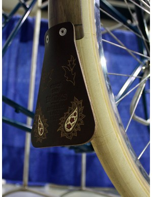 The leather fender flaps on the Banjo Cycles tourer were sourced from Brooks but custom decorated by Kara Ginther Leather
