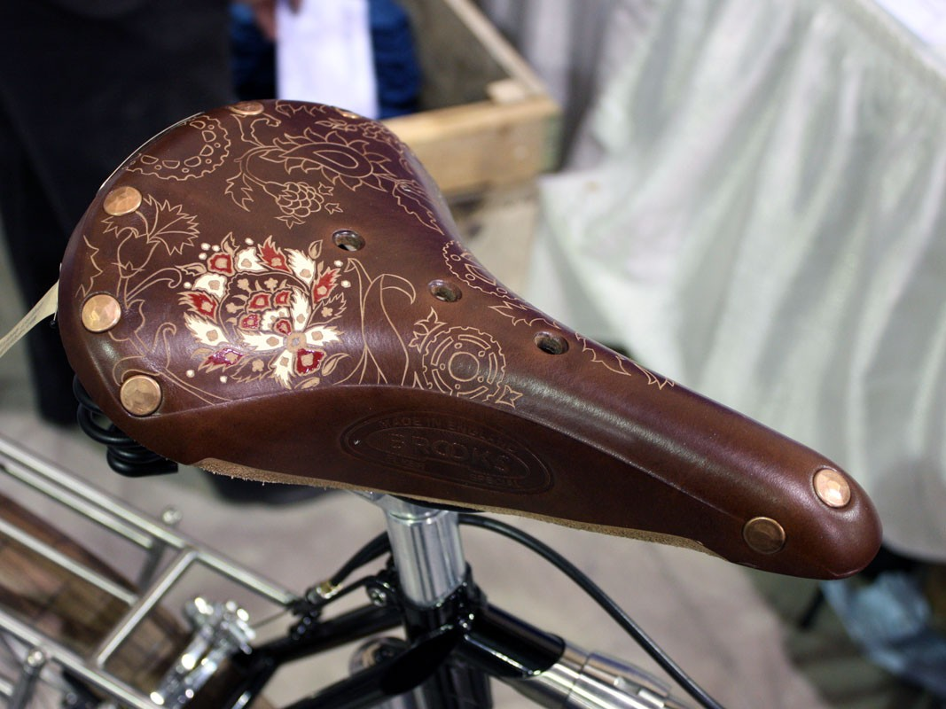 Brooks make the saddle but the artwork comes courtesy of Kara Ginther Leather