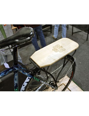 Shamrock Cycles topped the rear rack with this nicely finished wooden shelf