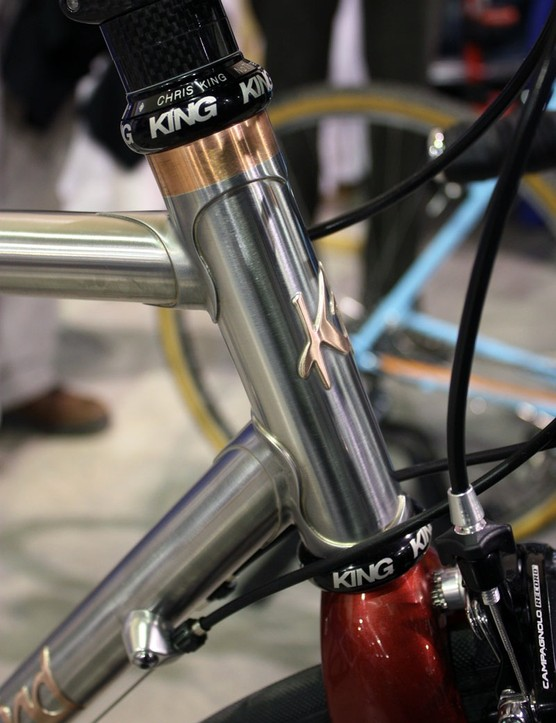 Copper accents offset the stark stainless steel on this Kelly Bedford road bike.