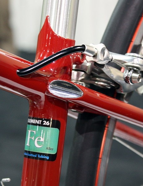 The internally routed rear brake cable on this Domínguez exits just ahead of the polished seat stay cap.