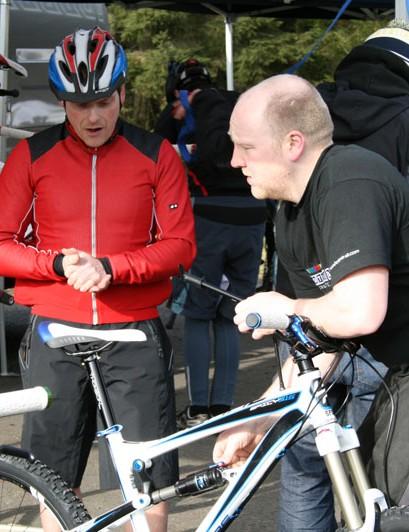 Mechanics receiving feedback after test ride