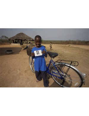With a photo of his sponsor, this young man is all smiles.