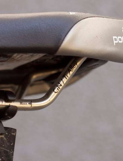 The podium features titanium rails and rear scuff guards.